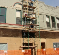 Front of museum, awnings removed and text added by Diaz Sign Art, front of building painted.