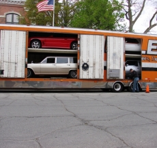 Cars begin to arrive in Pontiac.