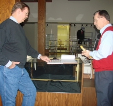 Tim Dye and Mayor Bob Russell discussing the floor plan of the museum.